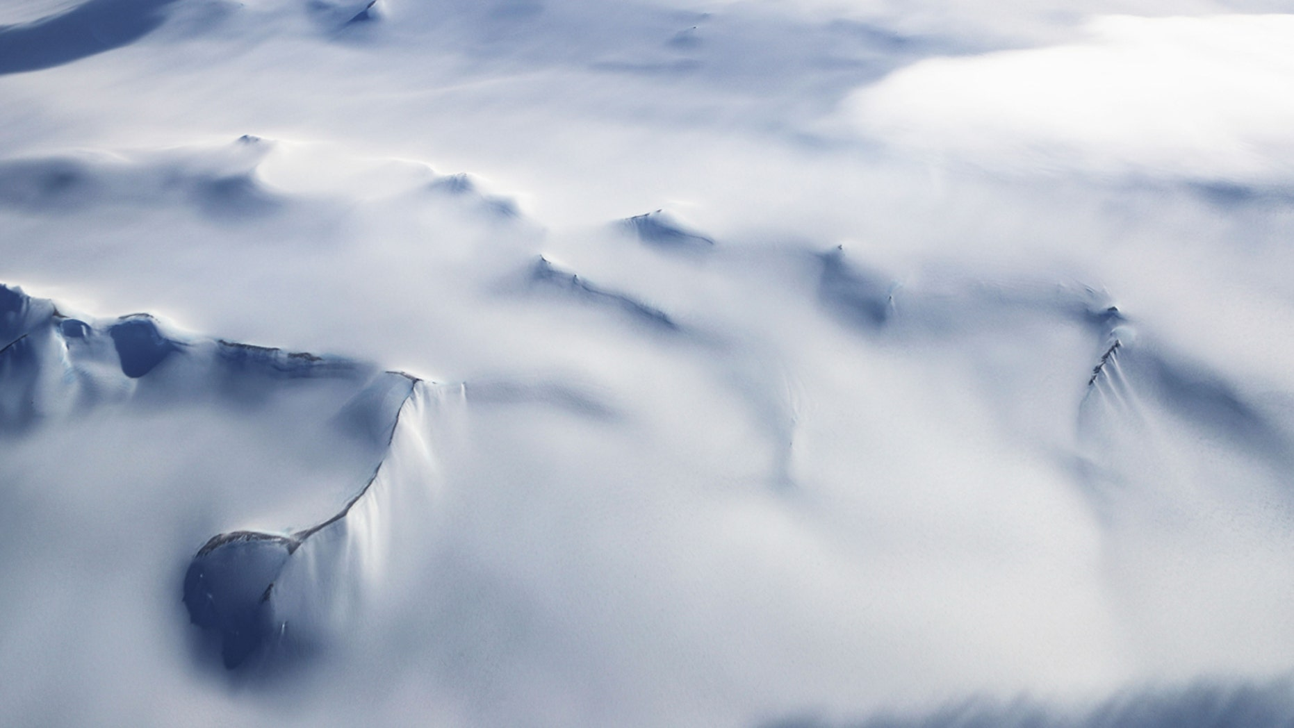 Mountain peaks are seen from NASA's Operation IceBridge research aircraft in the Antarctic Peninsula region, on November 4, 2017, above Antarctica.