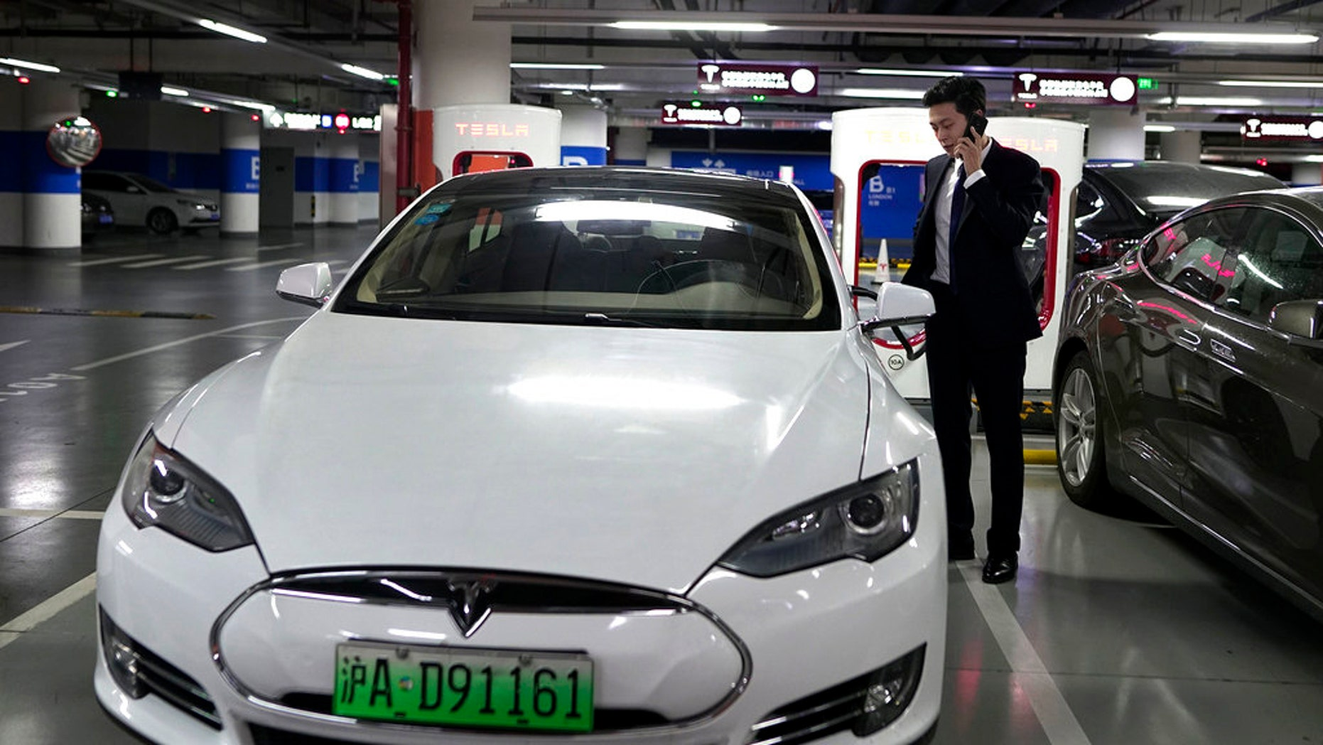chinese government's monitoring of electric cars raises surveillance