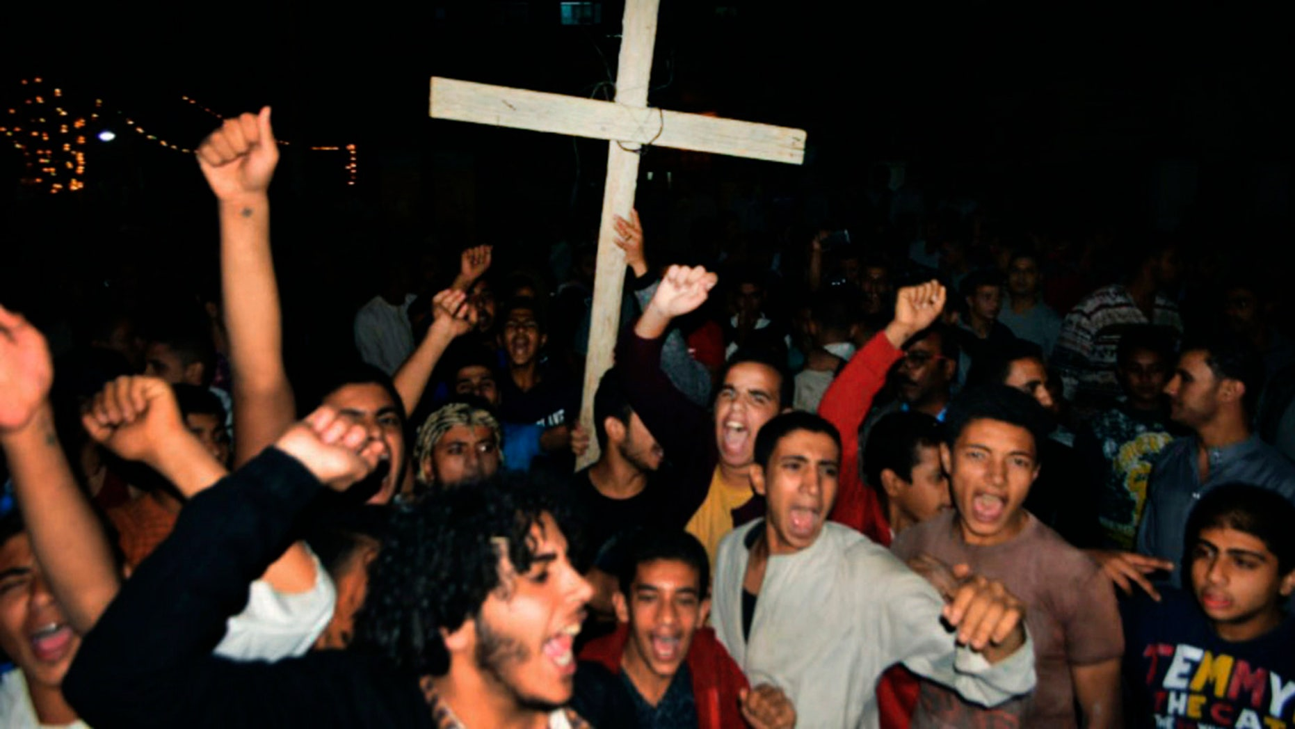 Coptic Christians chant slogans during a protest following an attack on a bus carrying Christian pilgrims on their way to a remote desert monastery in Minya Egypt Friday Nov. 2 2018