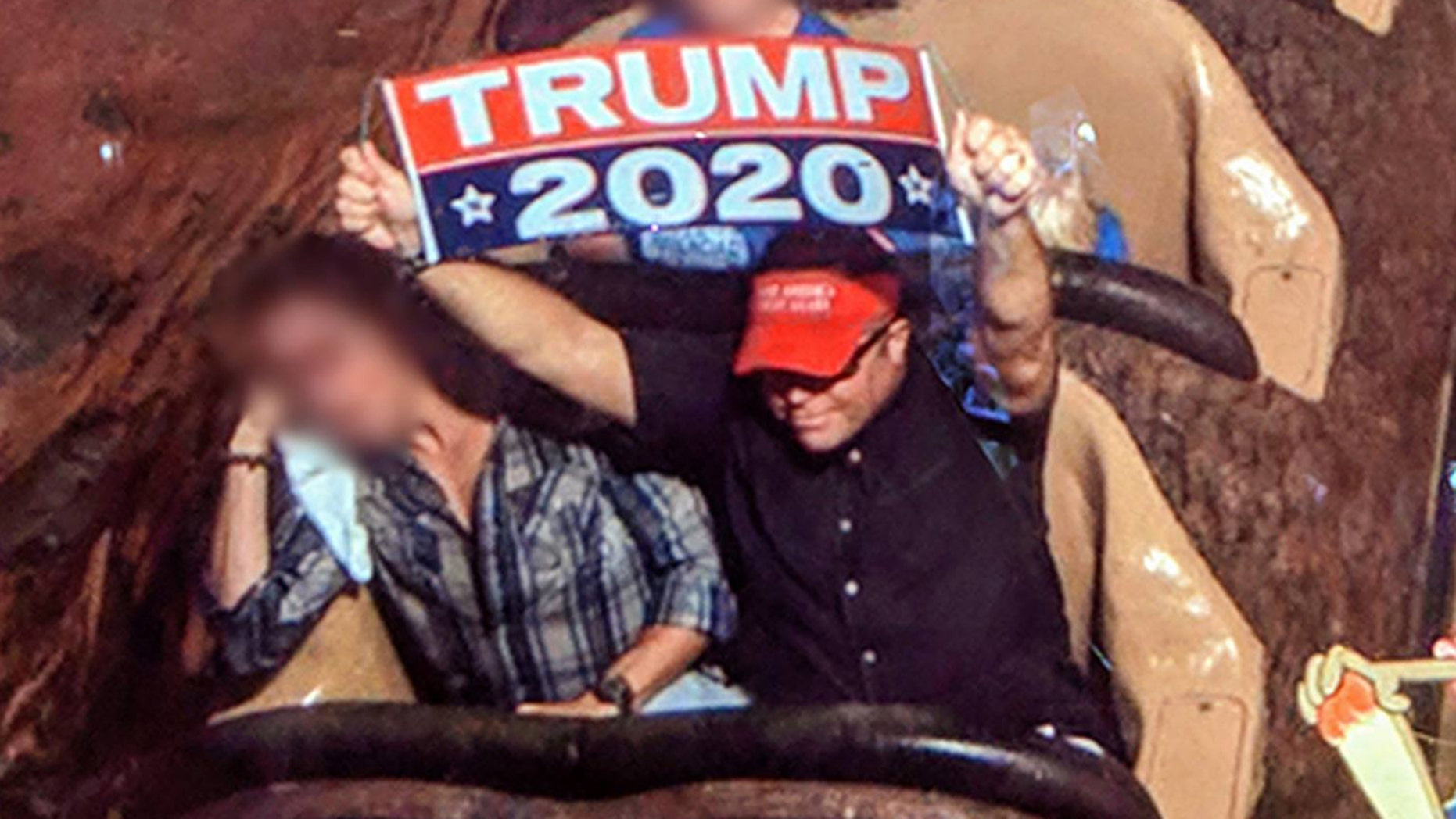 A man has been banned from Disney World for the second time after violating the rule that prohibits guest from displaying signs or banners at the park.