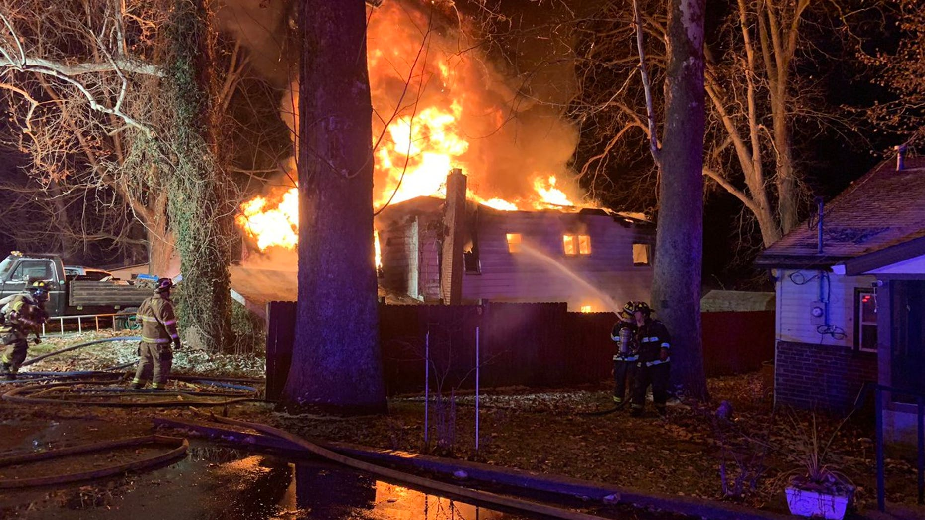Firefighters respond to an early morning fire in rural Indiana.