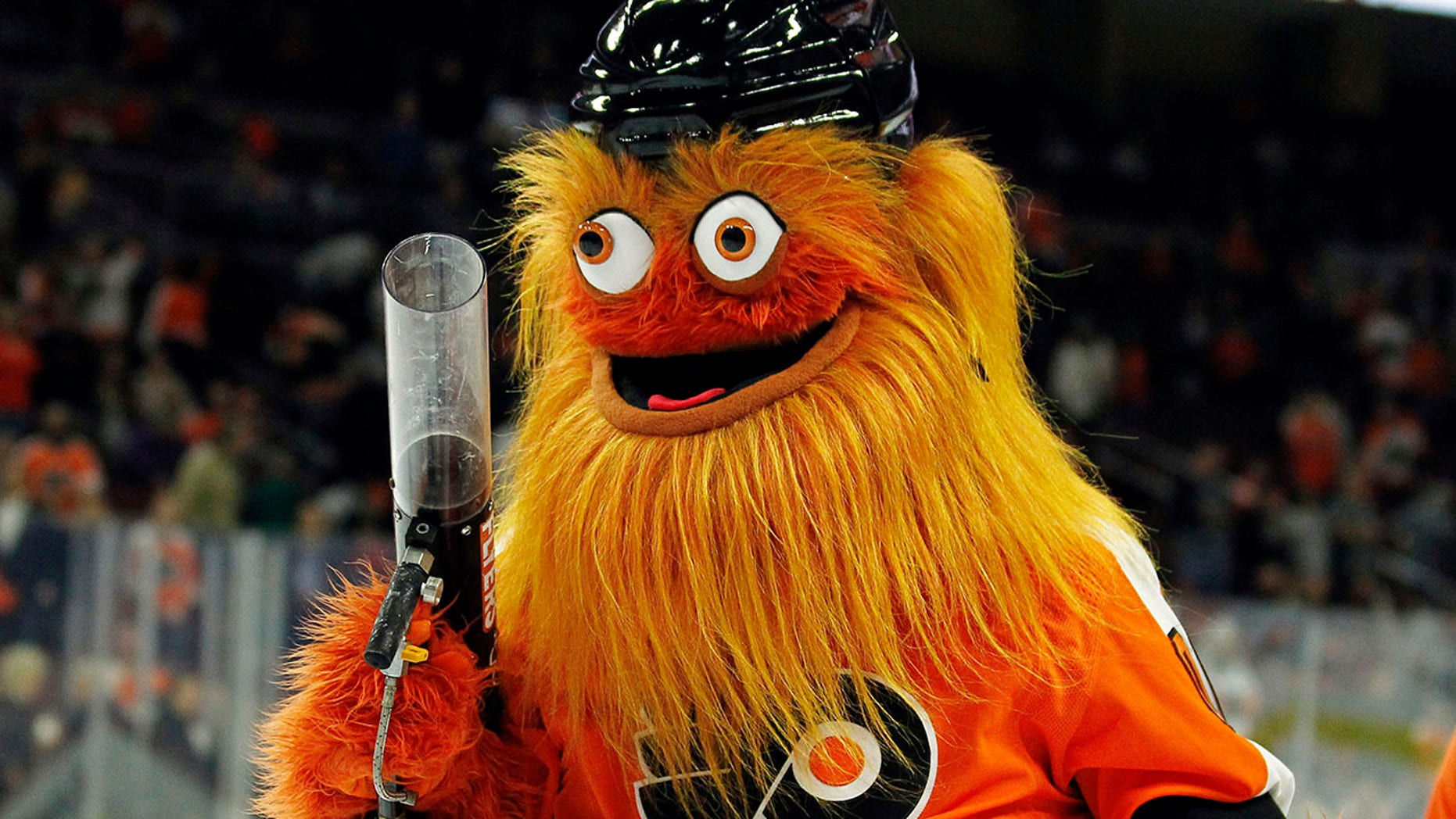 FILE - In this Sept. 24, 2018, file photo, the Philadelphia Flyers new mascot, Gritty, takes to the ice during the first intermission of the Flyers' preseason NHL hockey game against the Boston Bruins in Philadelphia. What better way to surprise a Philadelphia wedding party than with Gritty? CBS Philly reports newlyweds were shocked when the buck-eyed, 7-foot mascot for the NHL's Flyers showed up Friday night, Nov. 23, 2018, and started dancing to laughs and applause.