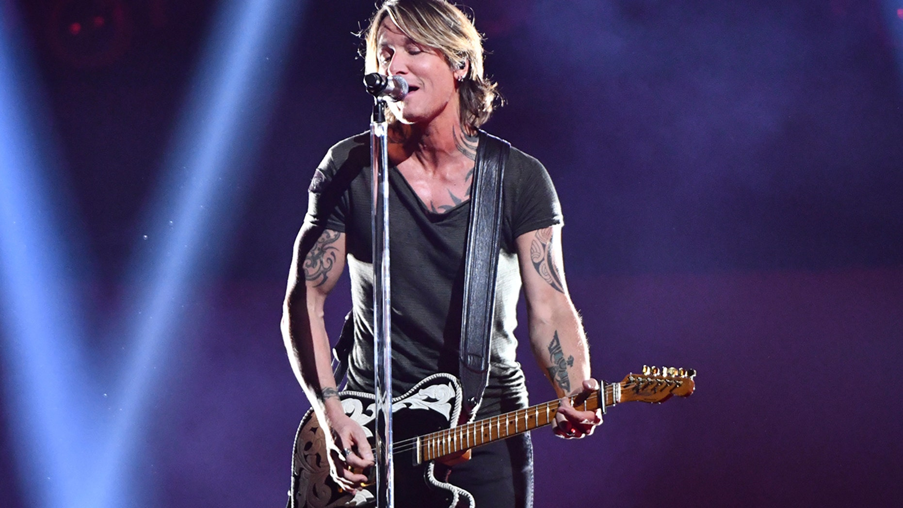 """Following his performance of """"Never Comin' Down,"""" Keith Urban took home the Entertainer of the Year award at the CMAs on Wednesday."""