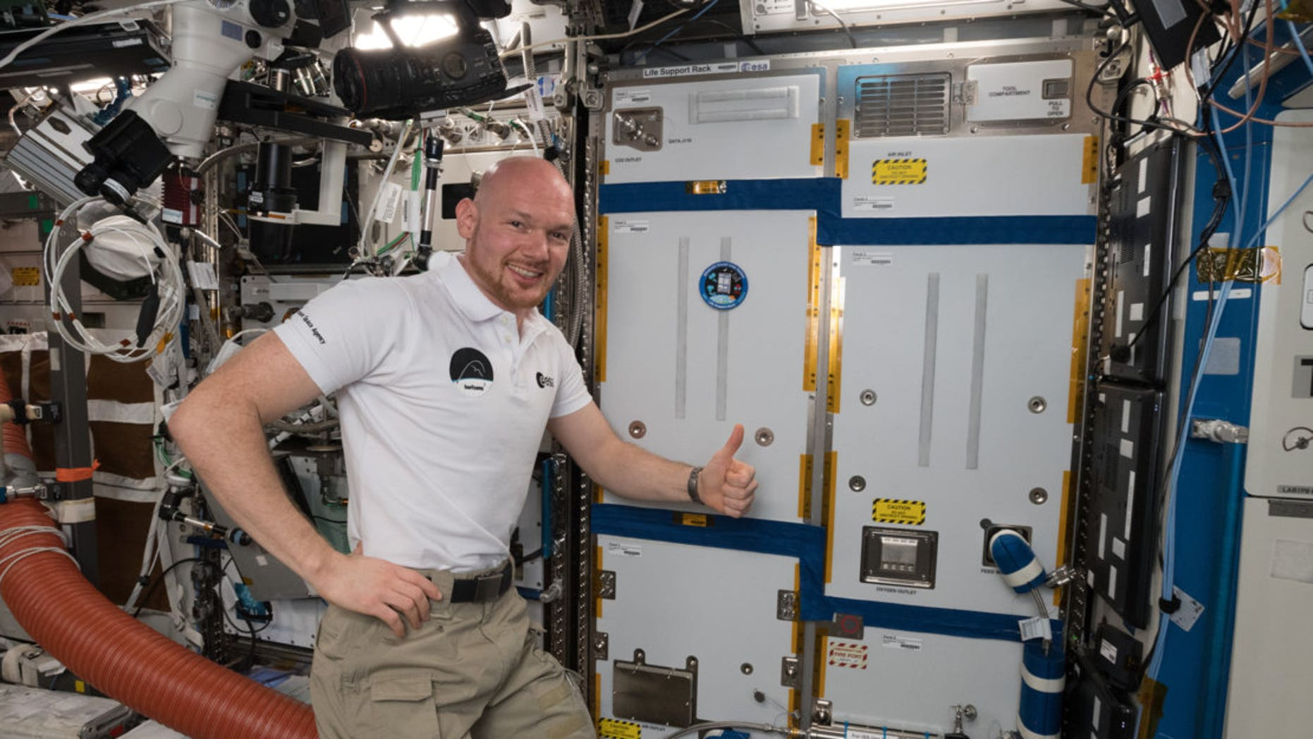 ESA astronaut Alexander Gerst poses on Oct. 19, 2018, with the ACLS life-support rack, newly installed on the International Space Station.