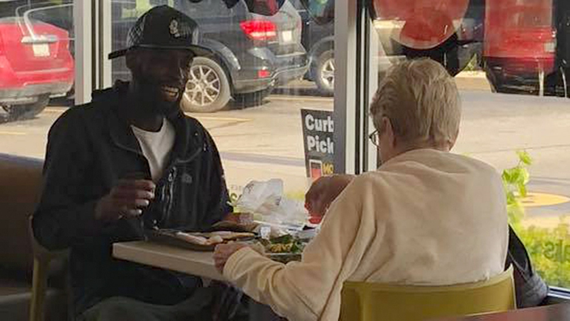 A pair of strangers sharing a meal at McDonald's has caught the attention of social media.