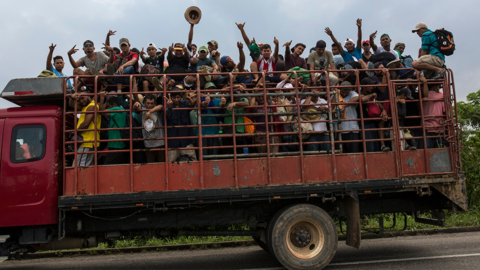 Members of one of the migrant caravans riding on a truck in Donaji Mexico last week