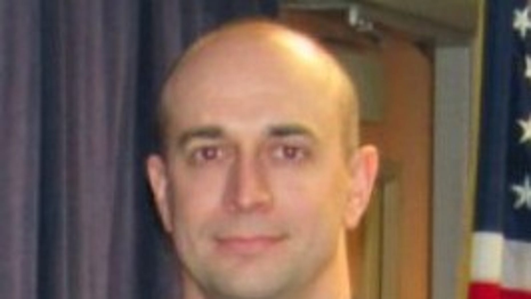 South Salt Lake Police Officer David Romrell, 31, was fatally and intentionally struck by a vehicle while responding to a burglary call in Utah on Saturday night, officials said.