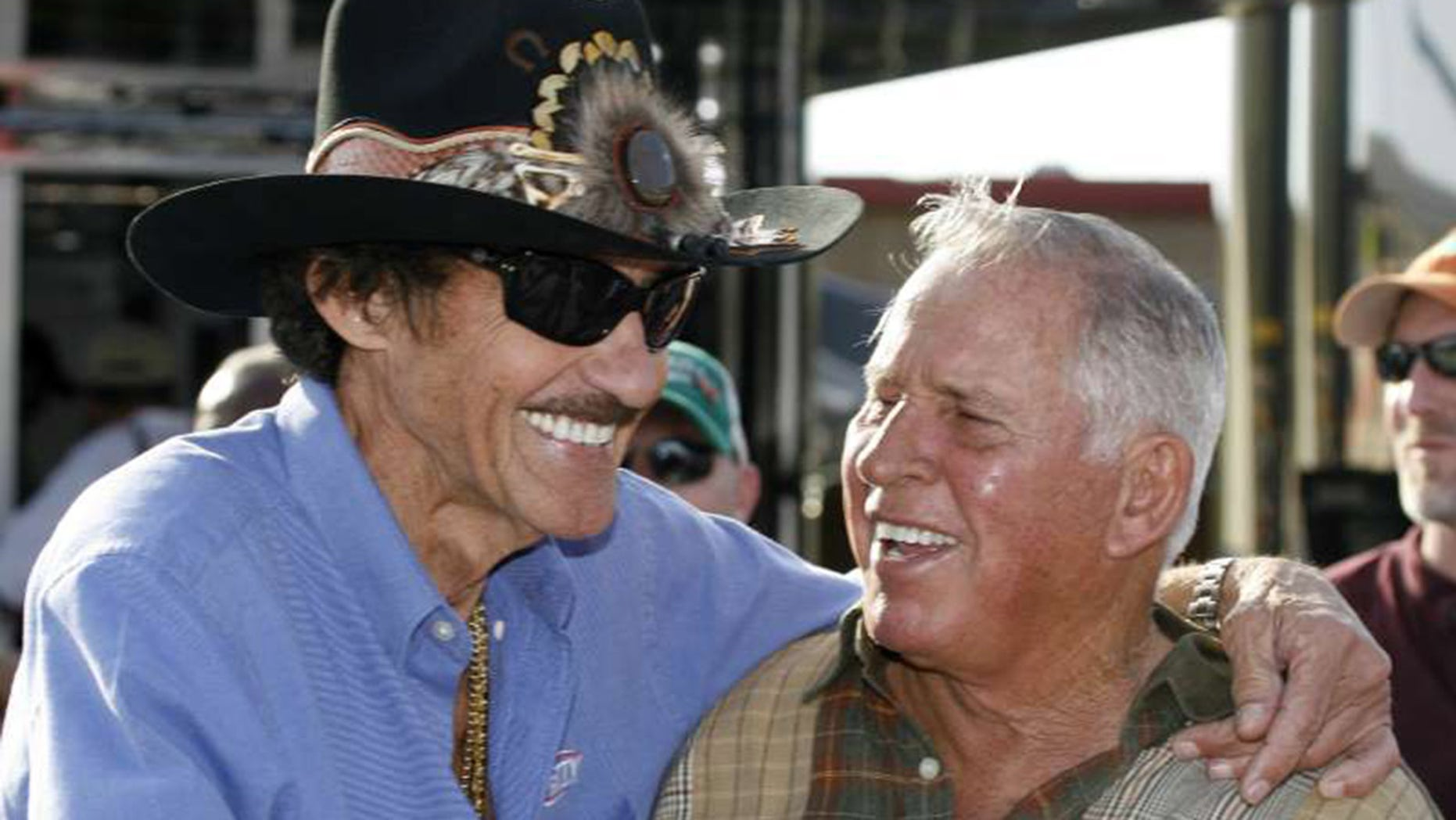 Pearson (r) is second to Richard Petty (l) on the all-time NASCAR wins list.