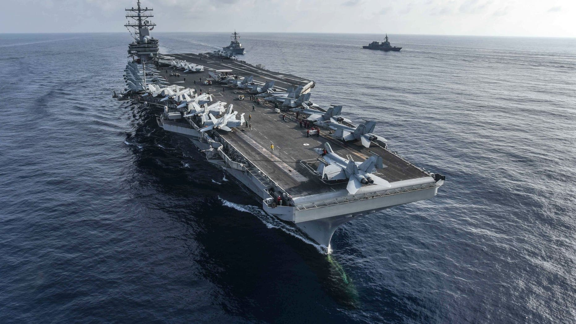 The F/A 18 crew was located by a USS Ronald Reagan search and rescue aircraft.