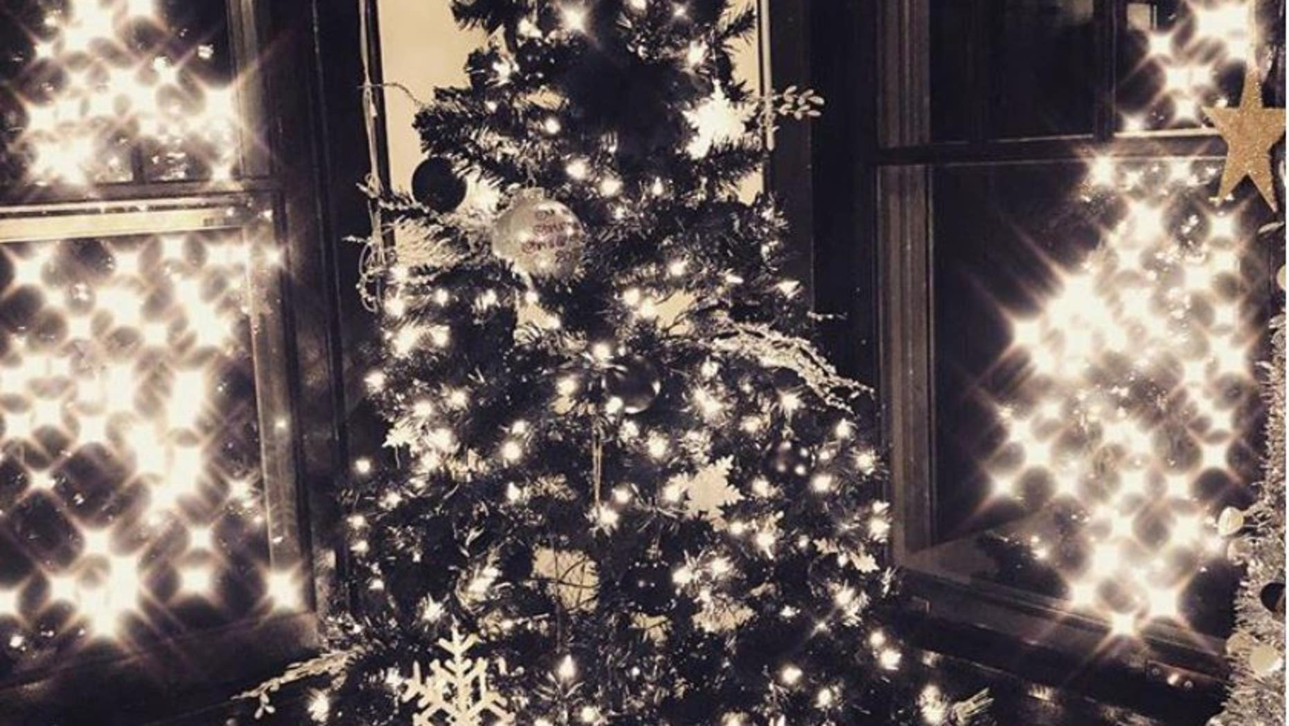 christmas fans are decorating their black christmas trees this year
