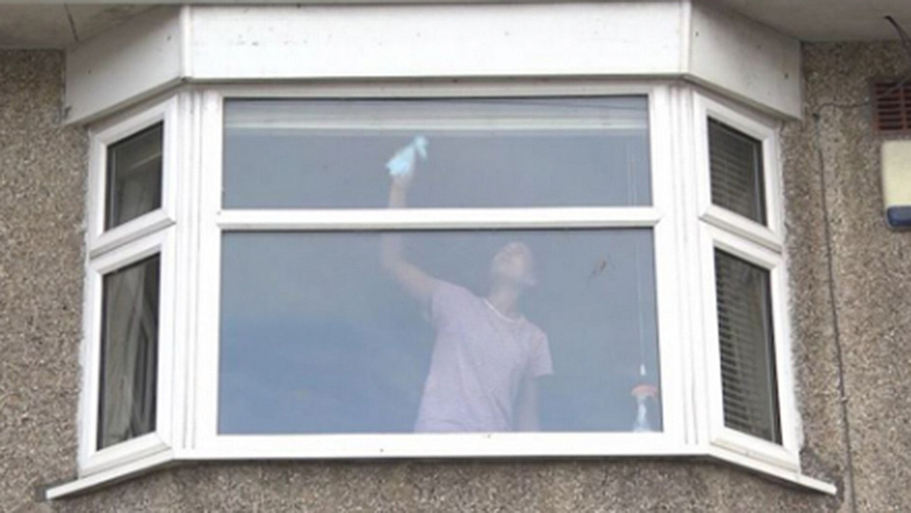This seemingly innocuous photograph of a woman cleaning her windows has been shared with a shocking warning