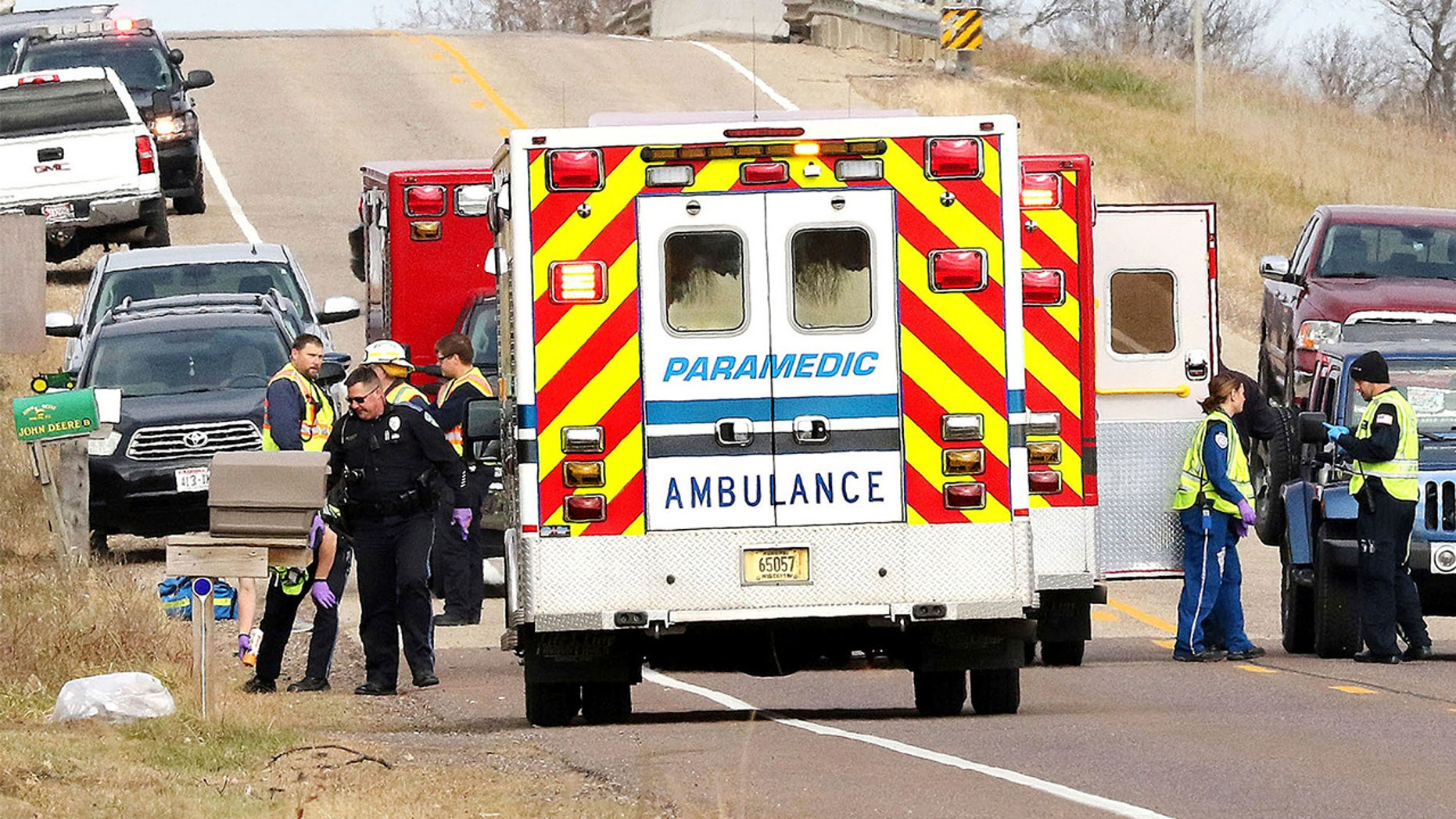 Emergency medical personnel gather at the scene of a hit-and-run accident Saturday, Nov. 3, 2018, in Lake Hallie, Wisconsin, that killed three girls and an adult. (Steve Kinderman/The Eau Claire Leader-Telegram via AP)