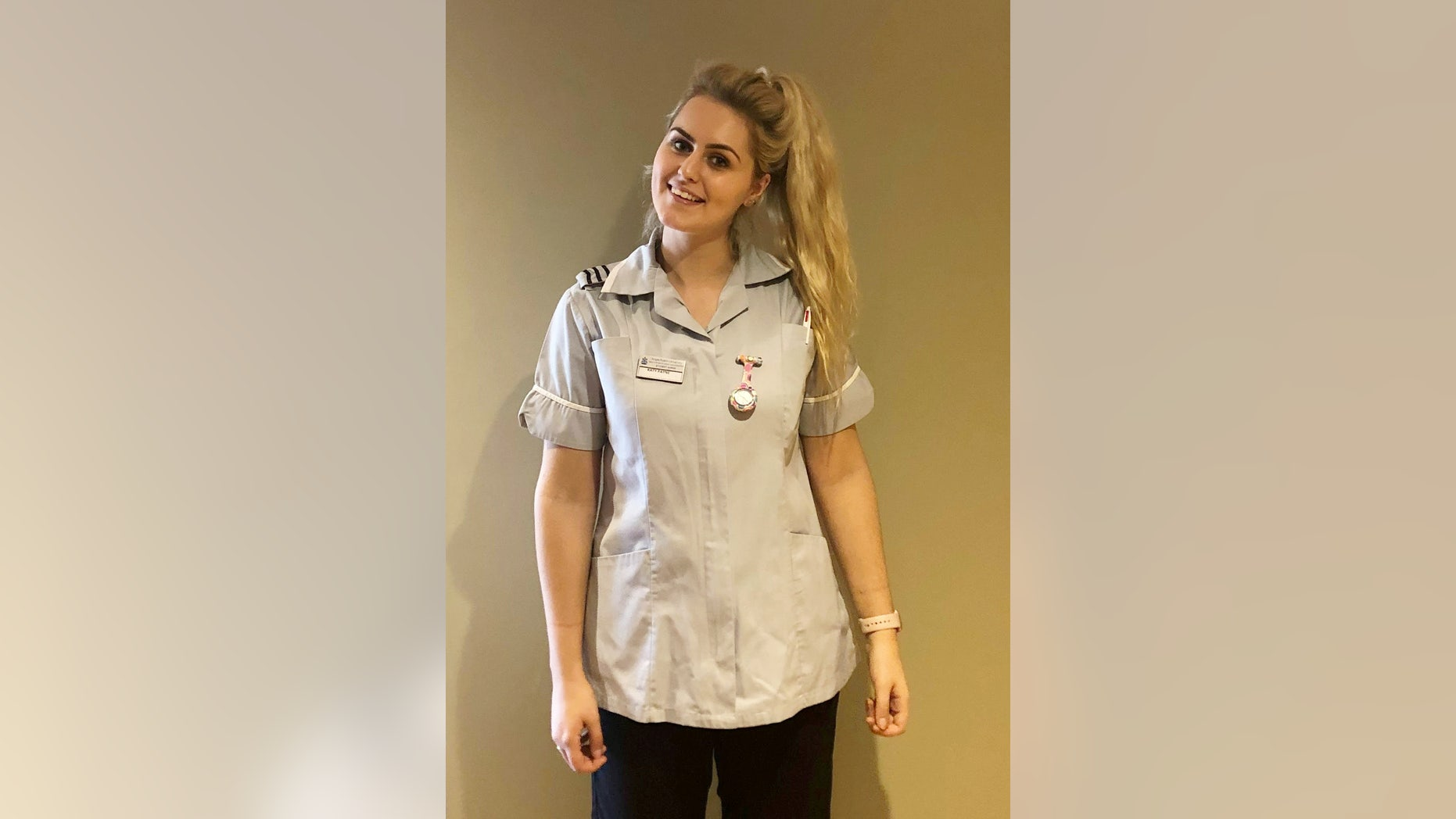 Katy Payne, 20, in her nurses outfit, is now working with some of the staff who helped care for her as a child.