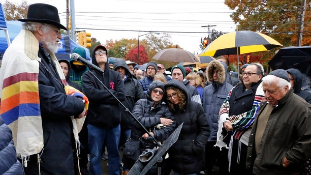 A week after the deadly Pittsburgh synagogue shooting that left 11 people dead, dozens of people reportedly came together for what a former rabbi described as a healing service outside the site of the bloodiest anti-Semitic attack in U.S. history. (AP Photo/Gene J. Puskar)