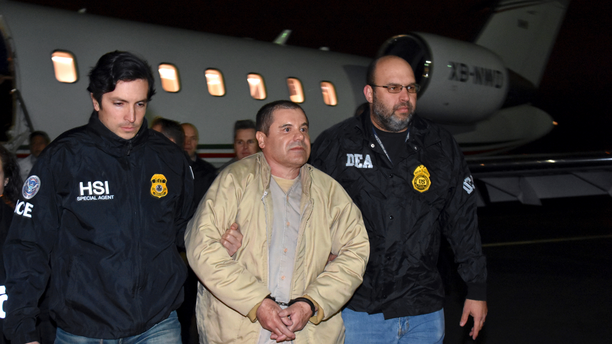"""FILE - In this Jan. 19, 2017 file photo provided U.S. law enforcement, authorities escort Joaquin """"El Chapo"""" Guzman, center, from a plane to a waiting caravan of SUVs at Long Island MacArthur Airport, in Ronkonkoma, N.Y. A jury has been picked for the U.S. trial of the Mexican drug lord.  Seven women and five men were selected Wednesday, Nov. 7, 2018, as jurors in the case against Guzman. The trial is set to begin Nov. 13 with opening statements in federal court in Brooklyn. (U.S. law enforcement via AP, File)"""
