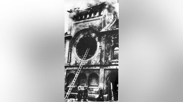 FILE - In this Nov. 10, 1938 file photo firefighters are at the Fasanenstrasse synagogue, Berlin's biggest house of Jewish worship, after Nazis set fire to it in anti-Jewish demonstrations throughout Germany known as Kristallnacht, Nov. 9,1938. (AP Photo)