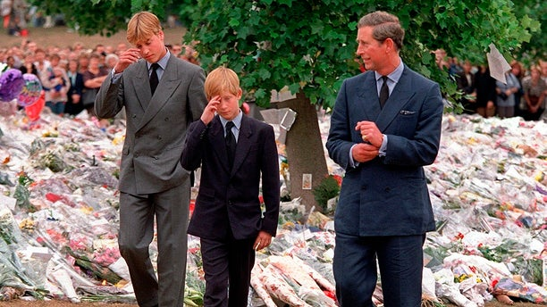 In this Friday, Sept. 5, 1997 file photo Britain's Prince Charles, right, accompanies his sons Prince William, left and Prince Harry after they arrived at Kensington Palace to view tributes left in memory of their mother Princess Diana in London.