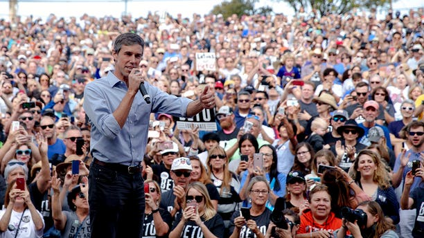 FILE - In this Nov. 4, 2018, file photo, Beto O'Rourke, the 2018 Democratic candidate for U.S. Senate in Texas, gives the thumbs up as he takes the stage to speak at the Pan American Neighborhood Park in Austin, Texas. O'Rourke didn't turn Texas blue, but for the first time in decades, it's looking much less red. Texas has long been a laboratory of conservatism. But cracks in the GOP's supremacy are emerging. The results could reverberate nationally. (Nick Wagner/Austin American-Statesman via AP, File)