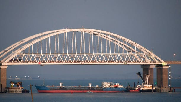 A ship under the Kerch bridge blocks the passage to the Kerch Strait near Kerch, Crimea.