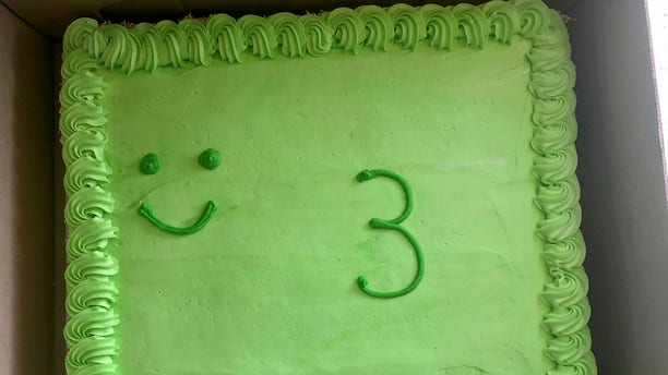 A disgusted dad has slammed an Australian supermarket after they allegedly ruined his son's frog-themed birthday cake with their 'pathetic' decorating skills.