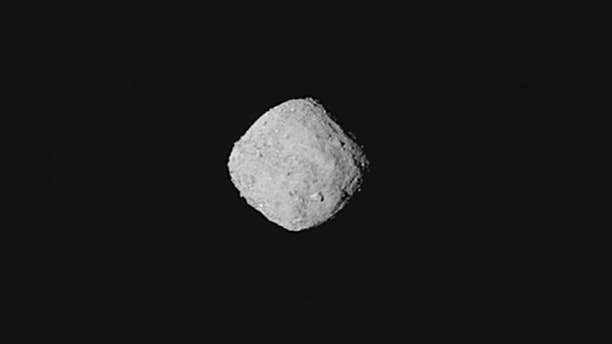 """This """"super-resolution"""" view of asteroid Bennu was created using eight images obtained by NASA's OSIRIS-REx spacecraft on Oct. 29, 2018, from a distance of about 205 miles. (NASA/Goddard/University of Arizona)"""
