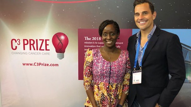 Bill Rancic with 2018 C3 Prize pitch winner, Ebele Mbanugo.