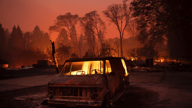 Flames burn inside a van as the Camp Fire tears through Paradise, Calif., on Thursday, Nov. 8, 2018. (AP Photo/Noah Berger, File)