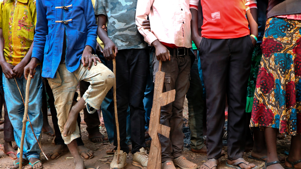 "FILE - In this Wednesday, Feb. 7, 2018 file photo, former child soldiers stand in line waiting to be registered with UNICEF to receive a release package, in Yambio, South Sudan. In an interview with The Associated Press in civil war-torn South Sudan, Romeo Dallaire, the former commander of the failed U.N. peacekeeping mission during the Rwandan genocide, says the current approach to combatting child soldier recruitment is not ""sufficient"". (AP Photo/Sam Mednick, File)"
