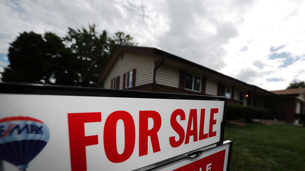 FILE- In this Oct 2, 2018, file photo, a for sale sign stands outside a home on the market in the north Denver suburb of Thornton, Colo. On Thursday, Nov. 15, Freddie Mac reports on this week's average U.S. mortgage rates. (AP Photo/David Zalubowski)