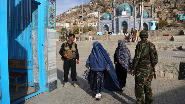 In this Tuesday, Oct. 30, 2018, photo Afghan security guard the gate of the Karti Sakhi shrine in Kabul, Afghanistan. Synagogues, mosques, churches and other houses of worship are routinely at risk of attack in many parts of the world. And so worshippers themselves often feel the need for visible, tangible protection even as they seek the divine. (AP Photo/Rahmat Gul)