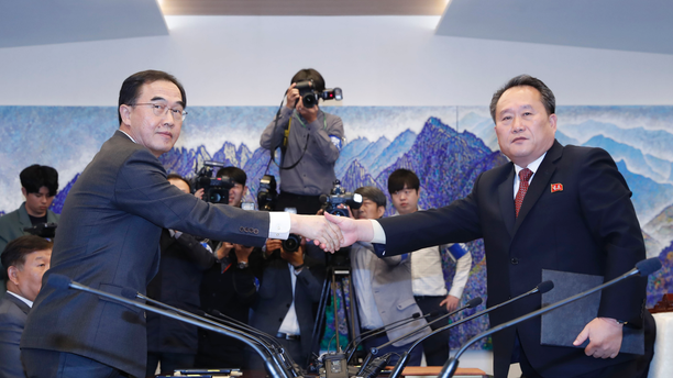 FILE - In this Oct. 15, 2018, file photo, South Korean Unification Minister Cho Myoung-gyon, left, shakes hands with his North Korean counterpart Ri Son Gwon after exchanging the joint statement during their meeting at the southern side of Panmunjom in the Demilitarized Zone, South Korea. South Korea says the United Nations Security Council has granted sanctions exemption for surveys on North Korean railroad sections the Koreas want to connect with the South. (Korea Pool/Yonhap via AP, File)