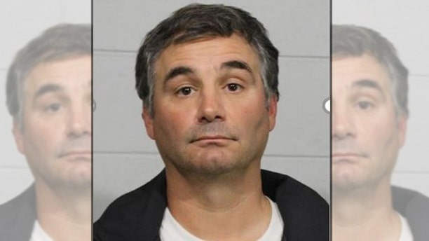 Marcus Dempsey, 43, was arrested on Monday after slapping a youth football player who injured his son on a tackle, police said.