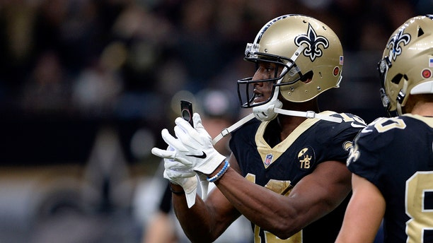 New Orleans Saints wide receiver Michael Thomas (13) pulls out a cell phone after his 72-yard touchdown reception in the second half of an NFL football game against the Los Angeles Rams in New Orleans, Sunday, Nov. 4, 2018.