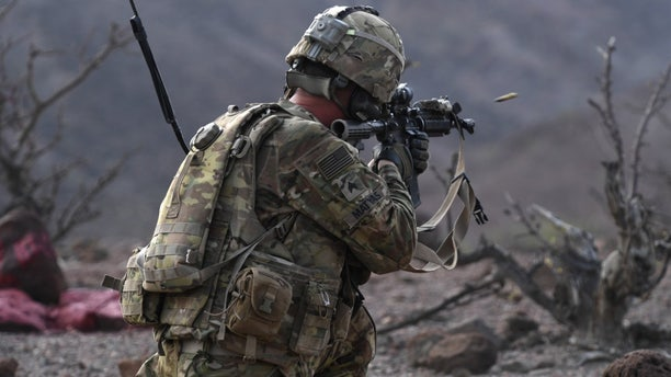 File photo - A 10th Mountain Division Soldier fires an M4 rifle during a platoon Situational Training Exercise at a range in Arta, Djibouti, Aug. 25, 2018. (U.S. Air Force photo by Senior Airman Haley D. Phillips)