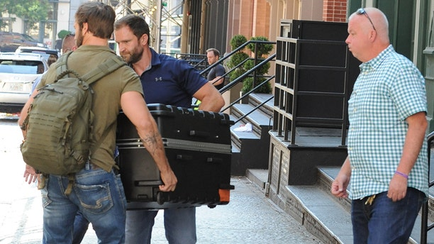 Taylor Swift being transported in a huge suitcase from her Tribeca apartment into her truck, in the trunk. A fleet of cars including two large cadillacs and three suv's arrive at Tailor Swift's apartment in Tribecca to move a large suitcase from apartment to truck. Almost a dozen of Taylor Swift security guards were present to move this package carefully as Taylor Swift remains to be unseen for a long time. Pictured: Taylor Swift Ref: SPL1539678 170717 NON-EXCLUSIVE Picture by: SplashNews.com Splash News and Pictures Los Angeles: 310-821-2666 New York: 212-619-2666 London: 0207 644 7656 Milan: 02 4399 8577 photodesk@splashnews.com World Rights