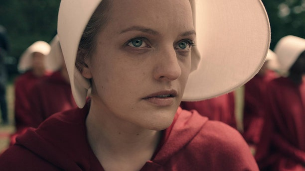 """Elisabeth Moss stars as Offred in Hulu's """"The Handmaid's Tale"""" based on Margaret Atwood's book."""
