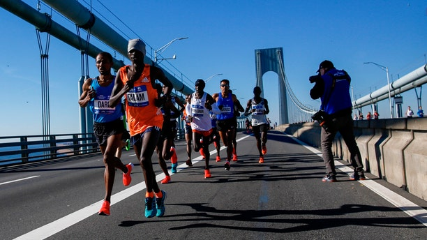Elite men runners cross the Verrazano-Narrows Bridge during the New York City Marathon on Sunday, Nov. 4, 2018, in New York.
