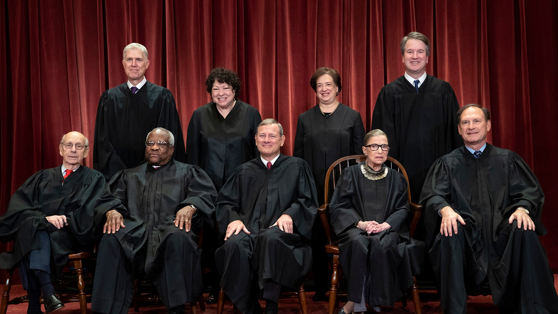 The justices of the U.S. Supreme Court gather for a formal group portrait to include the new Associate Justice, top row, far right, at the Supreme Court Building in Washington, Friday, Nov. 30, 2018.  (AP Photo/J. Scott Applewhite)