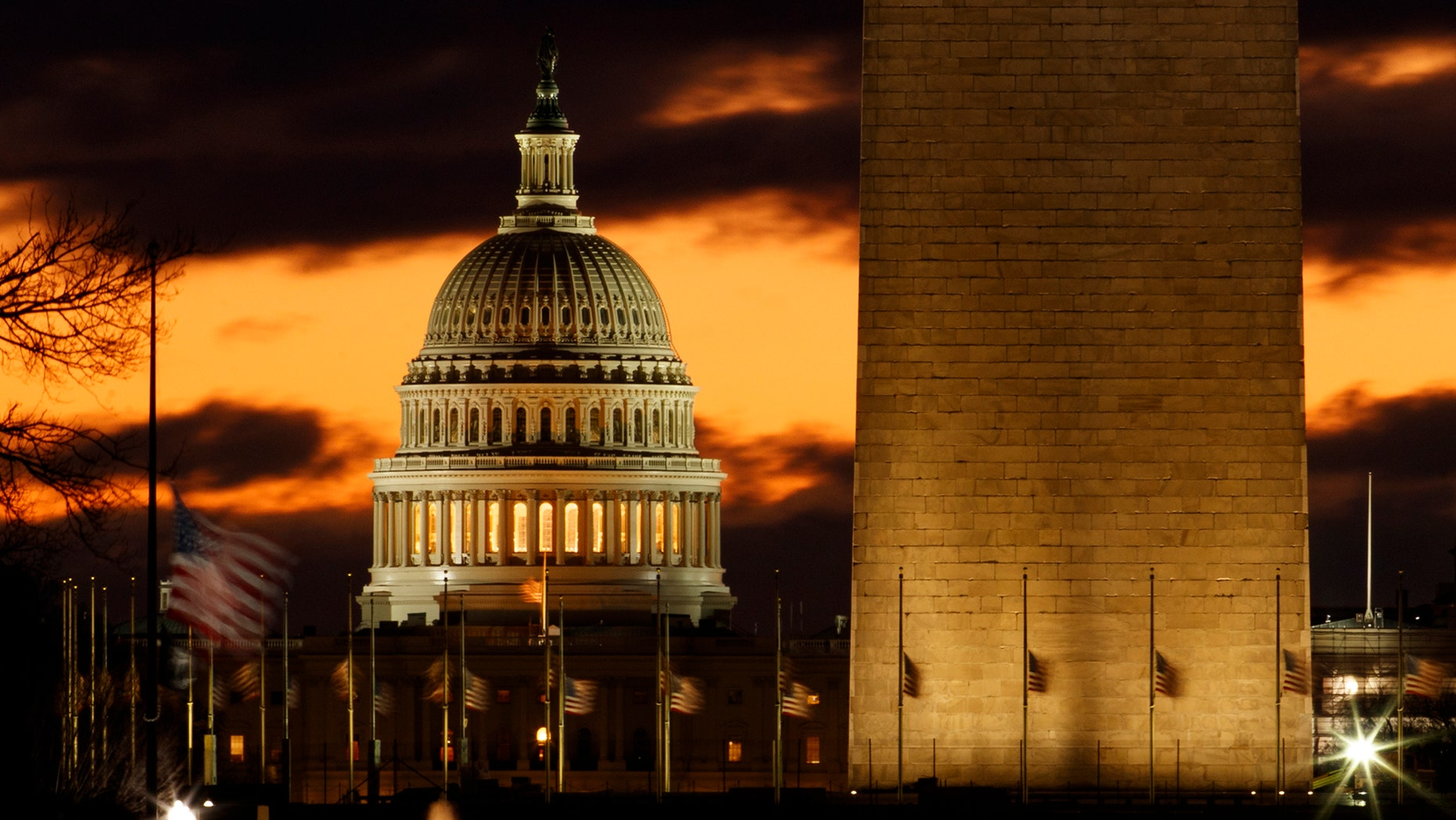 The U.S. Capitol dome is seen past the base of the Washington Monument just before sunrise in Washington, Saturday, Dec. 22, 2018. (AP Photo/Carolyn Kaster)