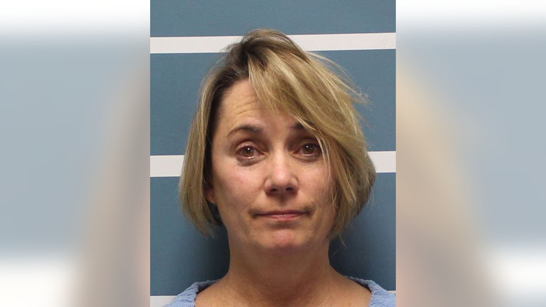 """Margaret Gieszinger, 52, was arrested after she was seemingly caught in a video cutting a student's hair while incorrectly singing """"The Star-Spangled Banner."""""""