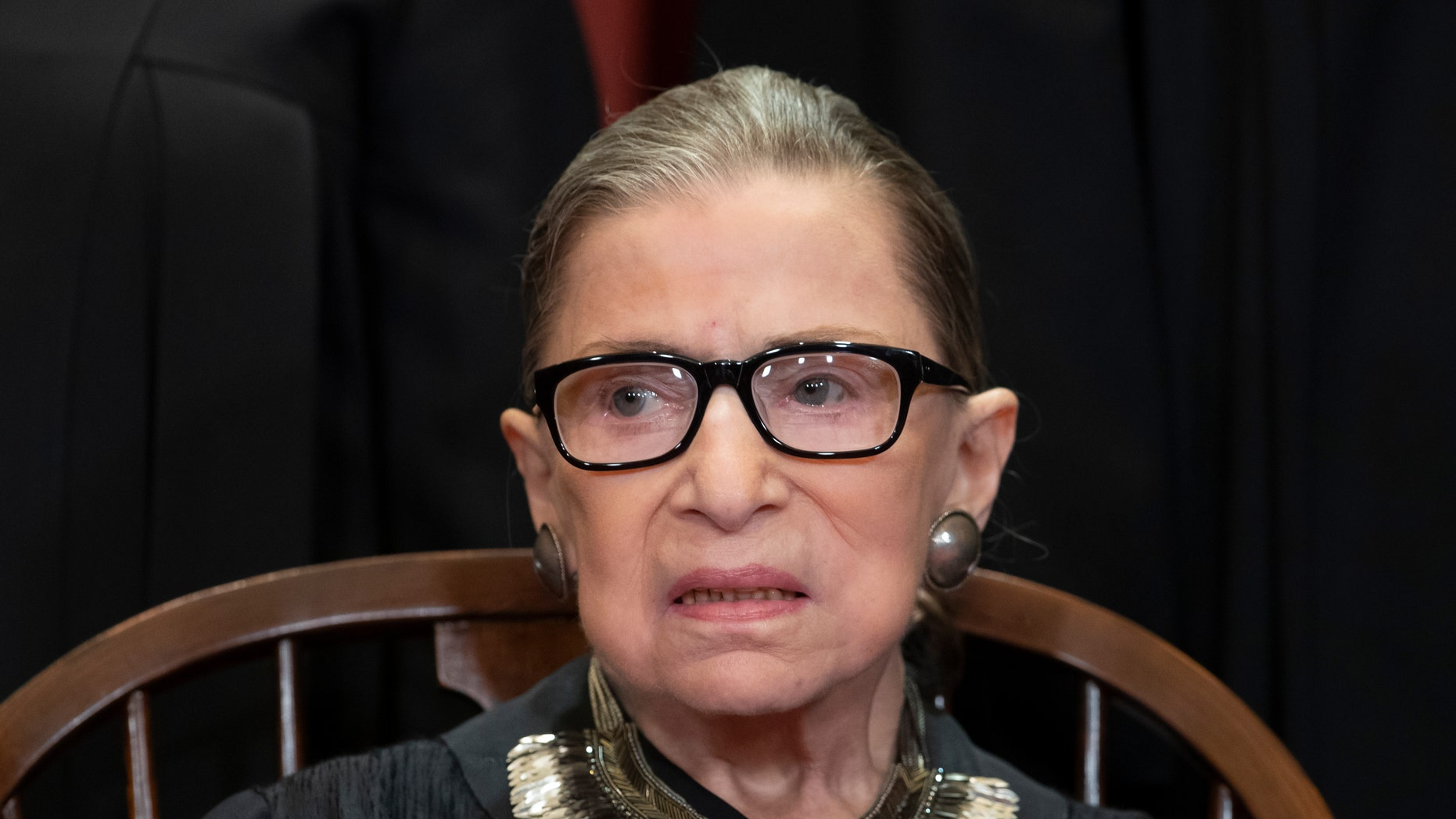 Ginsburg welcomes 31 new USA  residents at D.C. ceremony