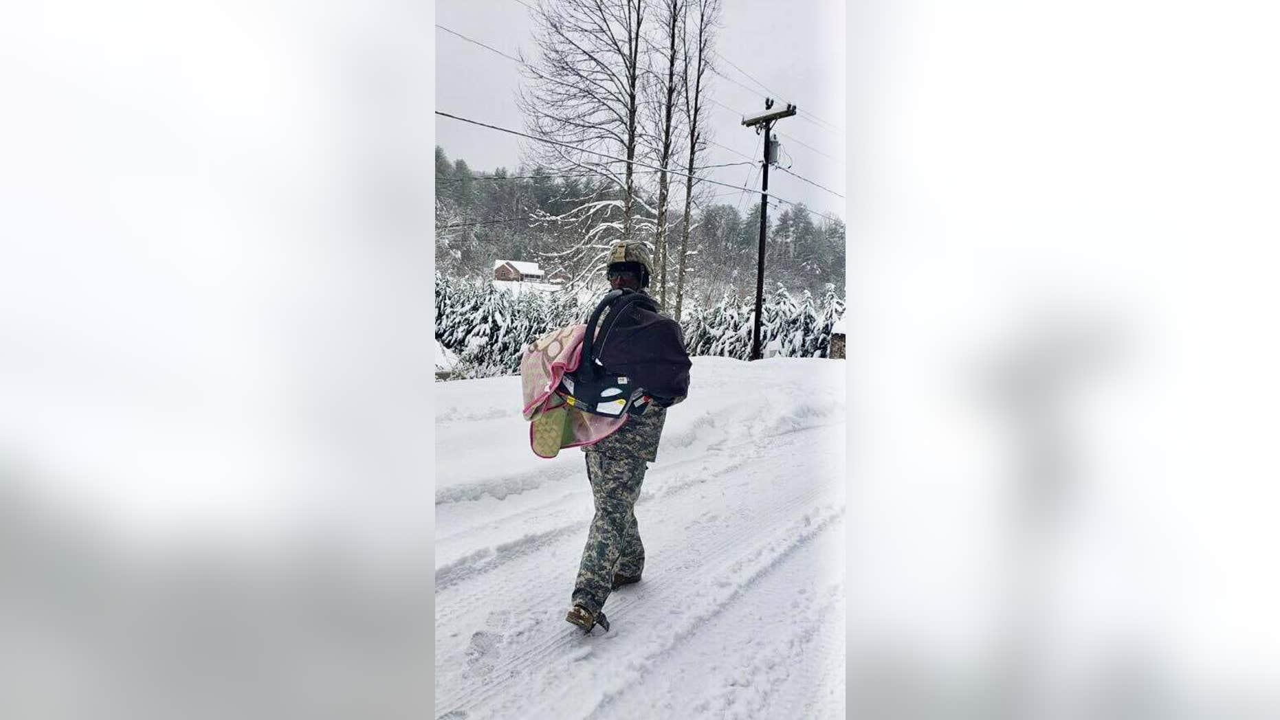 Sgt. Donovan McPherson, 27, was hailed a hero after he carried a baby in a car seat to safety.