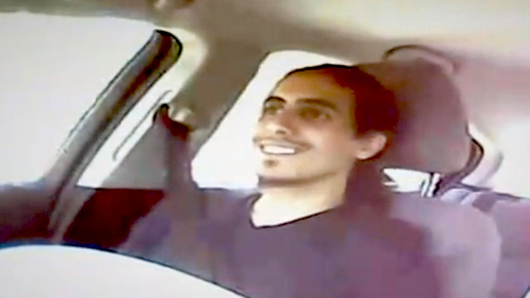 This image from video shows Amer Alhaggagi riding with an undercover FBI agent.
