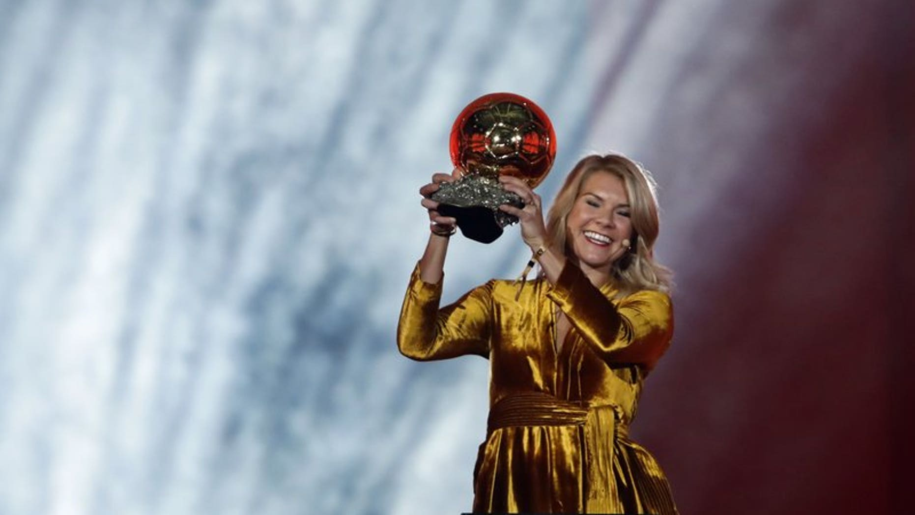 Olympique Lyonnais' Ada Hegerberg celebrates with the Women's Ballon d'Or award during the Golden Ball award ceremony at the Grand Palais in Paris,