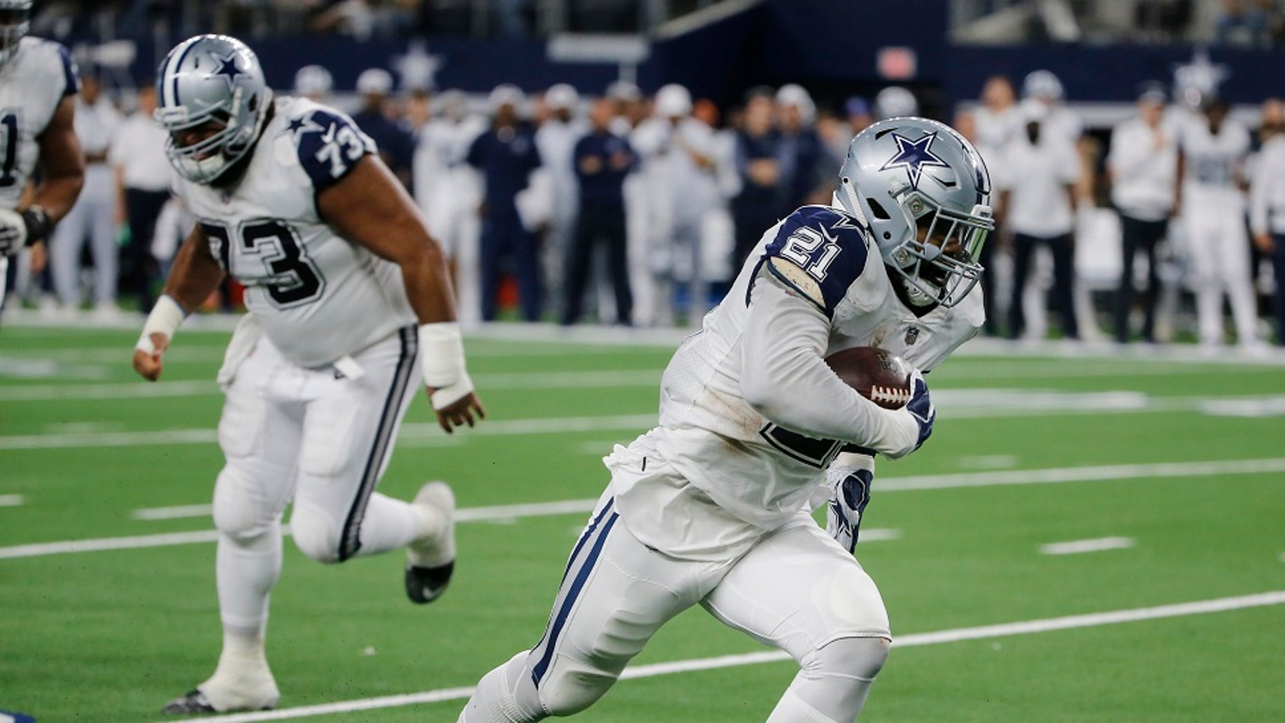 Dallas Cowboys running back Ezekiel Elliott (21) scores a touchdown against the New Orleans Saints in the first half of an NFL football game, in Arlington, Texas, on Thursday, Nov. 29.