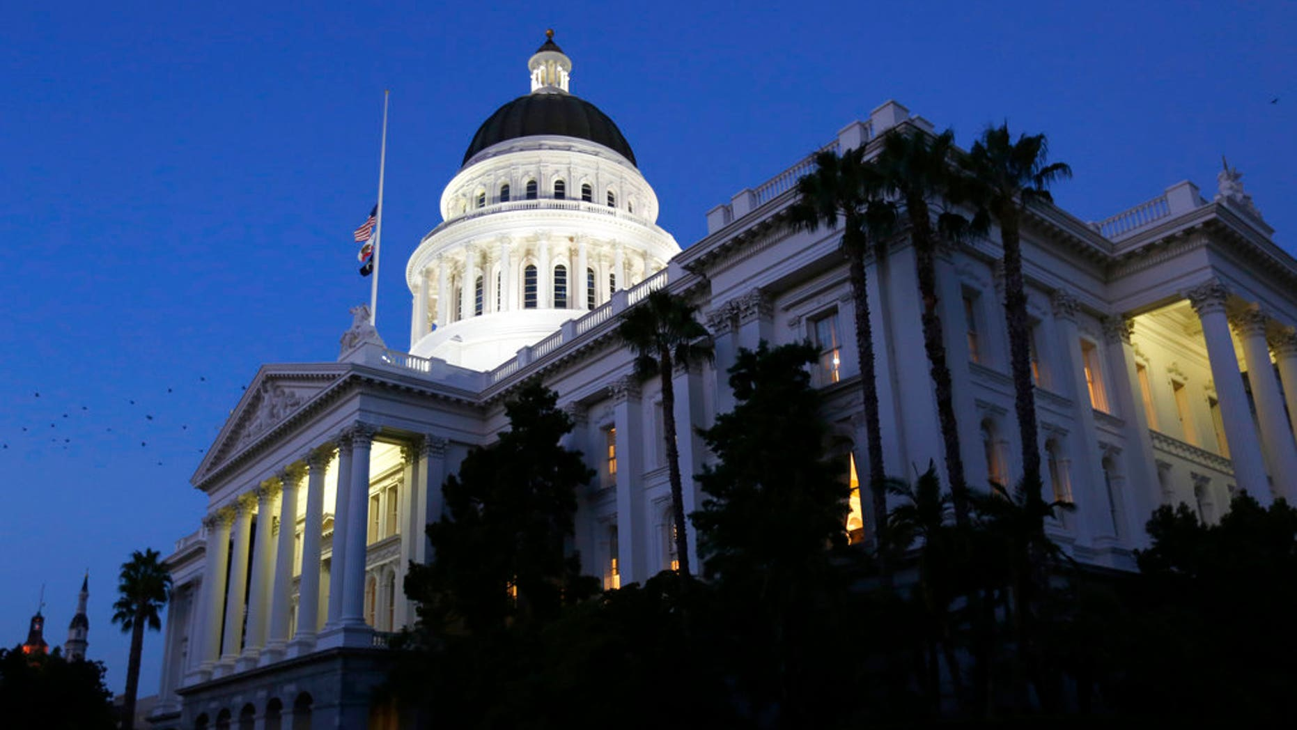 FILE: The lights of a Capitol architecture gleam as lawmakers work into a night on a final day of a 2017-2018 Legislative session, in Sacramento, Calif.