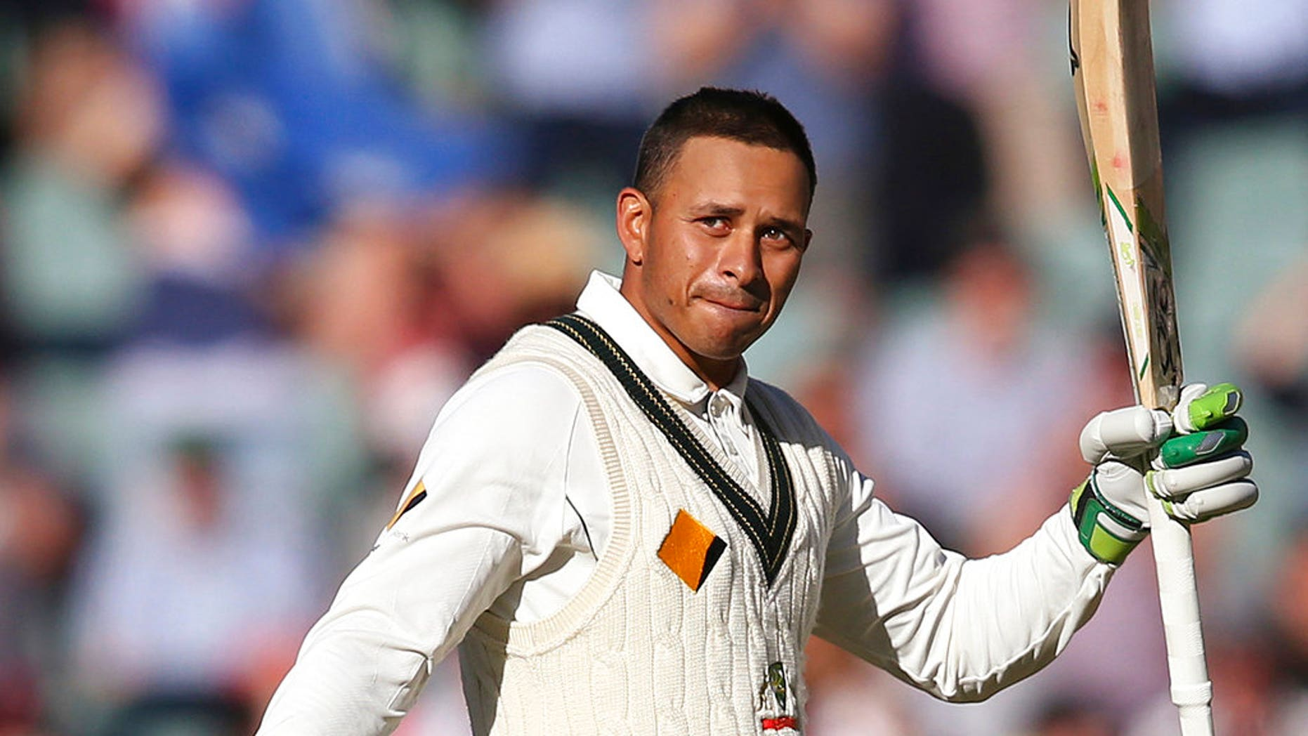 In this Nov. 25, 2016, file photo, Australia's Usman Khawaja celebrates making 100 runs against South Africa during their cricket test match in Adelaide, Australia. Khawaja's brother Arsalan Khawaja has been arrested, Tuesday, Dec. 4, 2018, as part of a counter-terrorism operation focusing on a plot to assassinate former prime minister Malcolm Turnbull.