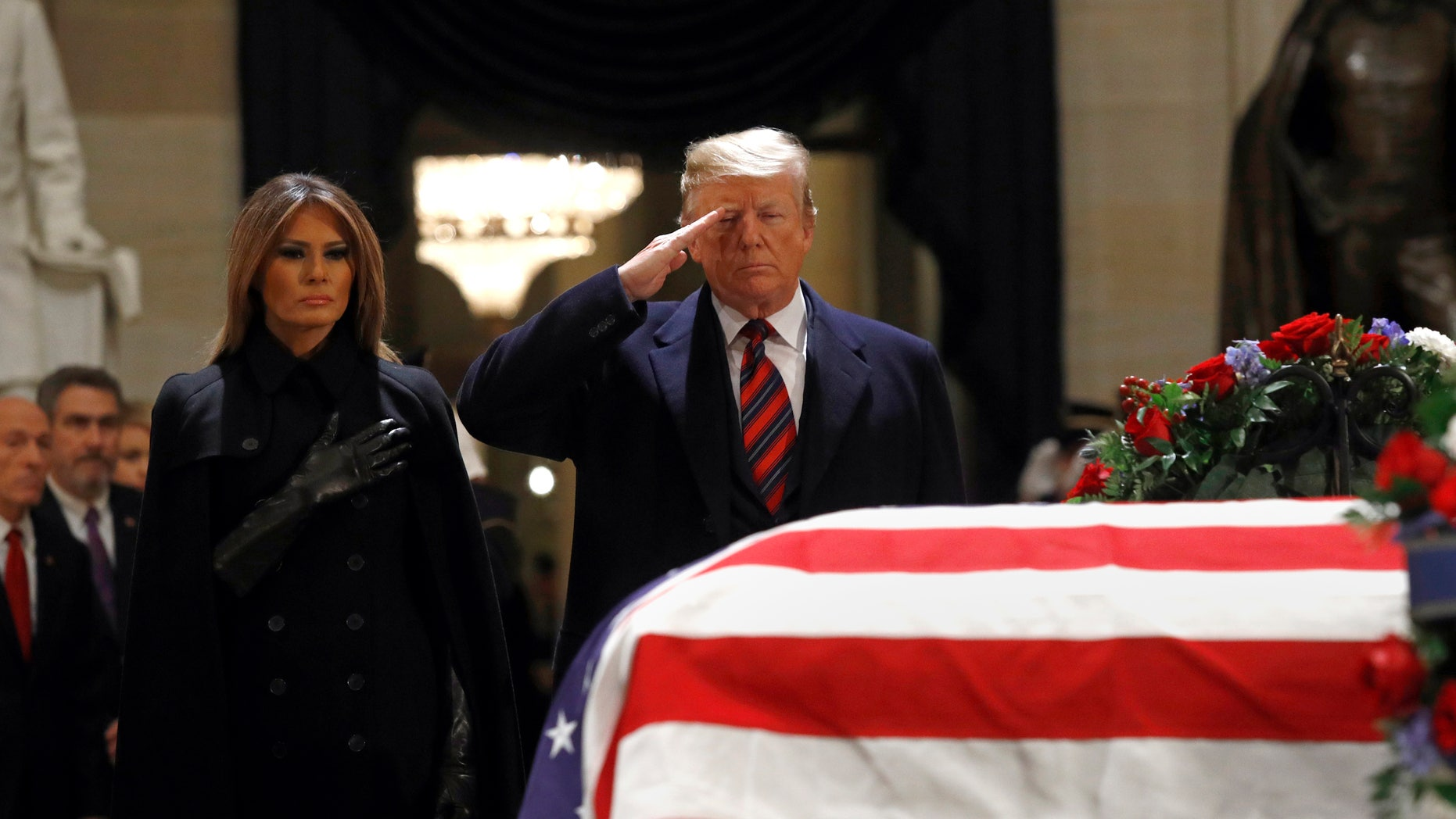 ABC News reporters joked about the future funeral of President Trump during coverage of George H. W. Bush's funeral. (AP Photo/Patrick Semansky)