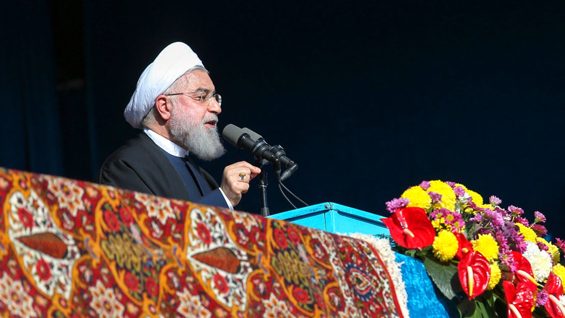 In this photo released by official website of the office of the Iranian Presidency, President Hassan Rouhani speaks in a public gathering in the northern city of Shahroud, Iran, Tuesday, Dec. 4, 2018. Rouhani threatened again to close the Strait of Hormuz, the passageway for nearly a third of all oil traded by sea. (Iranian Presidency Office via AP)