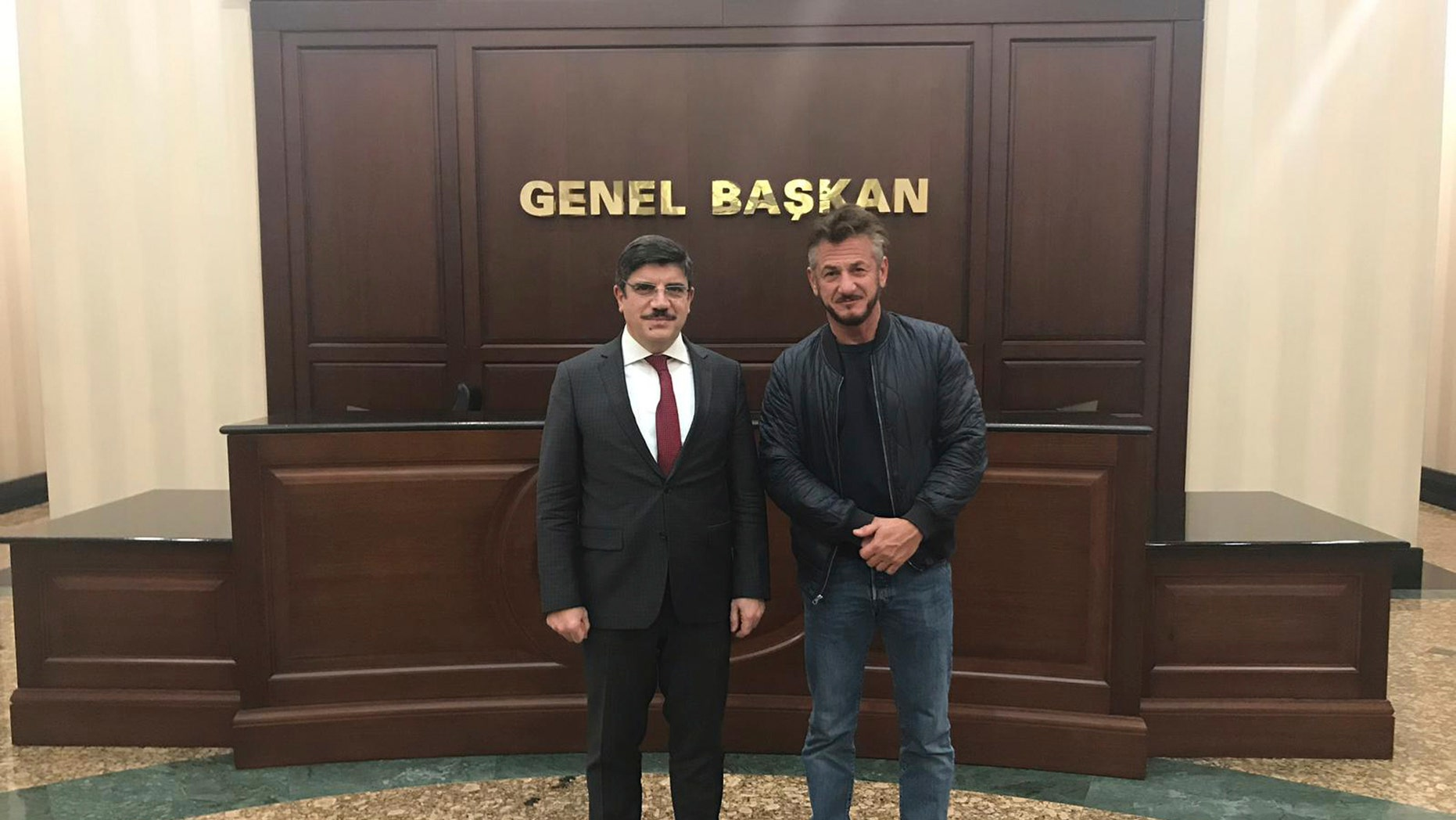 Yasin Aktay an adviser to Turkey's President Recep Tayyip Erdogan with US actor Sean Penn in Ankara Turkey. Penn is in Turkey working on a documentary about the slaying of journalist Jamal Khashoggi at the Saudi consulate on Oct. 2 in Istanbul
